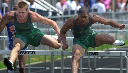 Cade Liverman 13-87 -2nd (left) and Kris Fant 13.86-1st, 110M Hurdles 2003 West NC 4A Regional Championships
