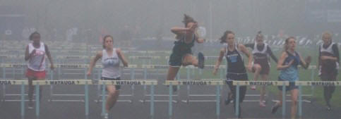 Juliana Haile, winning Conference Championship 100M Hurdles in the fog!